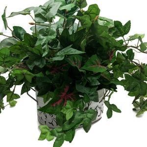 Small greenery arrangement in metal container